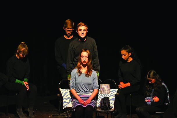 """The Custer High School one act play team performs its production of """"...And Others"""" at the State One Act Play Festival last week in Sioux Falls. Anna Marie Riner, center, played Amanda, a woman suffering from multiple personality disorder. Surrounding her are some of the various personalities she has developed to handle the traumatic memories from her childhood. From left, back, are Rachel Larcher, Danny Nelson, Miles Ellman, Odalys Estrada and Taylee Schramm. The play won a superior play trophy and six cast members recieved individual acting medals."""