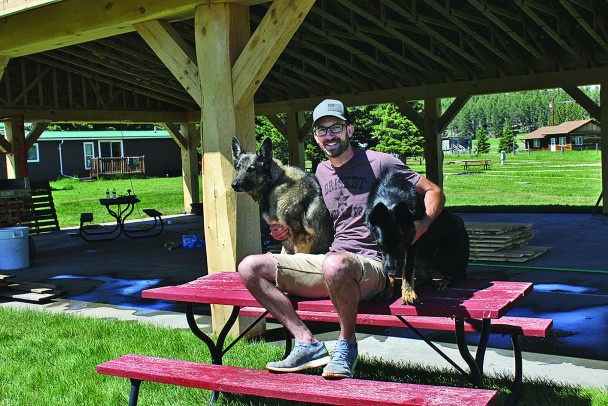 Kevin Hartman, the new owner of Wheels West RV Park & Campground and the 7th Cavalry Cafe, sits with his two canine buddies, Jade and Hank, in front of the newly-constructed pavilion at the campground. Hartman has big plans for the pavilion which will initially be the site of the 2020 Custer High School Prom June 19.