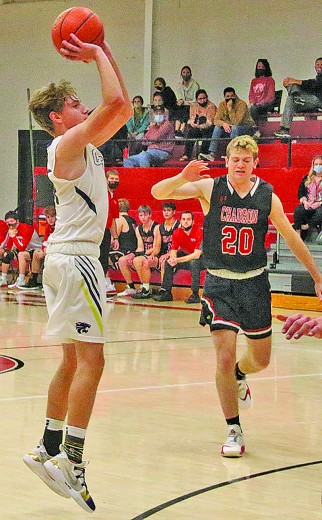 Gunner Prior fires a three-pointer during the championship game of the Chadron Rotary Club Holiday Classic in Chadron, Neb., last week. Prior had a team-high 15 points in the Wildcat's loss.