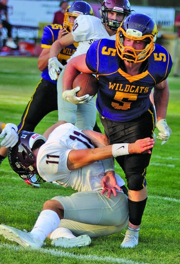Daniel Sedlacek runs through the tackle attempt of Spearfish's Derek Webster during last Friday evening's game against the Spartans. Sedlacek rumbled for over 300 yards in the game, while the Wildcats ran for over 500 yards as a team