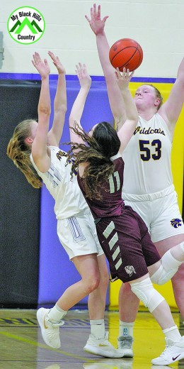 Spearfish's Erin Rotert attempts to take a shot over the defense of both Josey Wahlstrom and Kellyn Kortemeyer during last Thursday's game. The game was a rough and tumble one with a lot of contact, as the two teams combined for 51 fouls.
