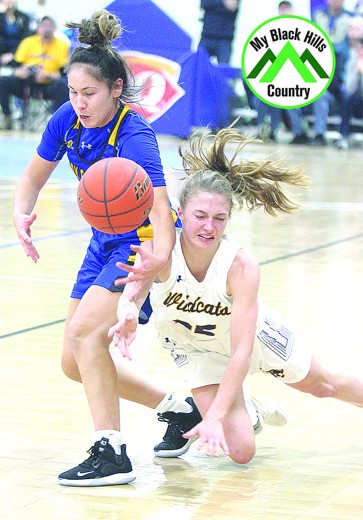 Josey Wahlstrom goes to the floor as she attempts to steal the ball from a Todd County player during last Saturday's game. Wahlstrom had 16 points in the game and was named to the all-tournament team at the conclusion of the game.