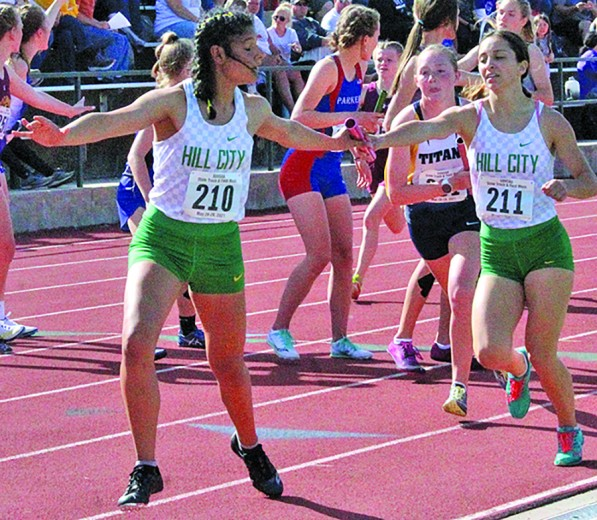 Nancy Falkenburg Brown hands the baton to Sara Dubois during the 3200 relay at last weekend's South Dakota Class AState Track Meet. The two were joined by Lillie Ross and Ryken Falkenburg Brown to run the race in 10:25.21, which was good for 12th place.