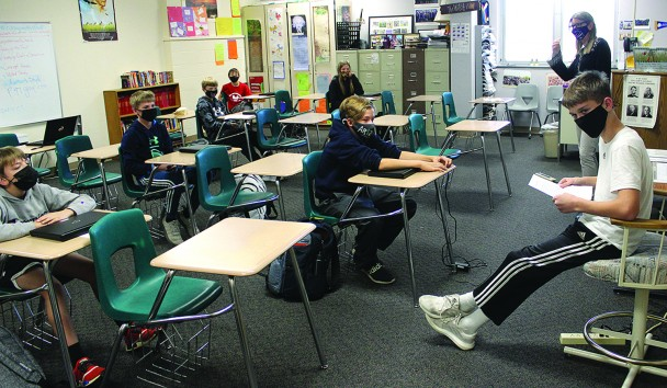 Students in Karen Karim's classroom at Custer Jr./Sr. High School wear masks as they listen to a fellow student read to them. Having been masked up because of COVID-19 for the past two weeks, the jr./sr. high students were joined in the mask mandate by students at Custer Elementary School and Hermosa School on Monday following a decision by the board of education Thursday night.