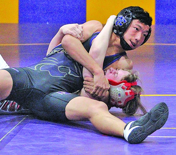 Wildcat wrestler Pierce Sword works to pin his opponent in a match at the Custer Invitational Wrestling Tournament on Friday. Sword pinned three opponents on Friday and Saturday and took third place in the 120-pound weight class.
