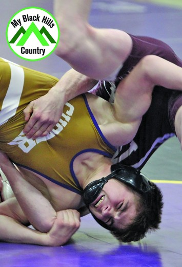 Jonathan Lewis, top, works to pin Mick King of Newcastle/Upton, Wyo. Thursday at the Custer Quad. Lewis got the job done in three-minutes-23-seconds. The Wildcats beat the Wyoming team in their dual by a score of 45 to 21.